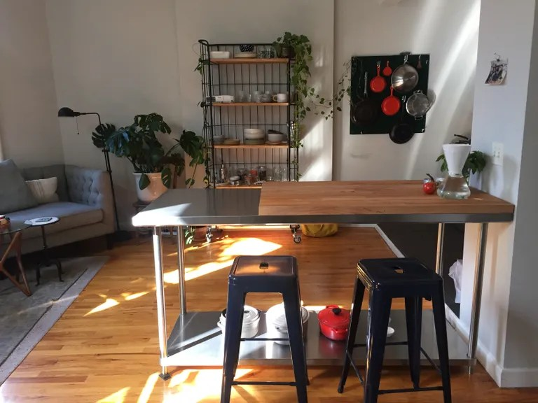 Why a Stainless-Steel Table is the Best Fix for a One-Wall Kitchen