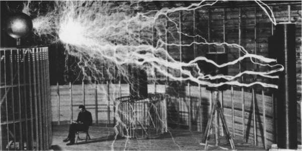 Nikola Tesla reading a book 2
