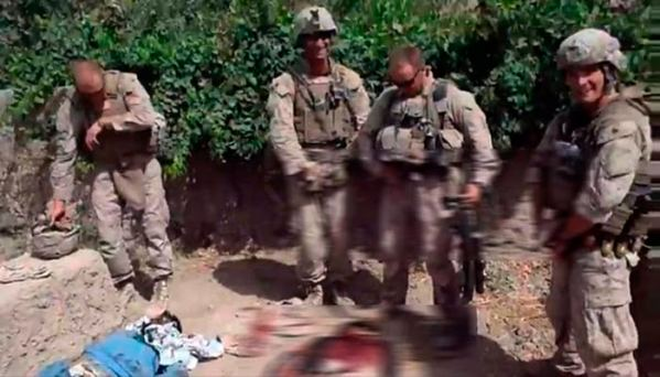 Marines urinating on dead bodies. [Reuters]
