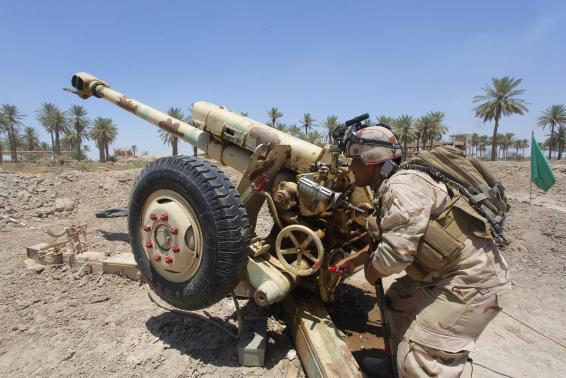 Iraqi security forces fire artillery during clashes with Sunni militant group Islamic State of Iraq and the Levant (ISIL) in Jurf al-Sakhar June 14, 2014. REUTERS/Alaa Al-Marjani