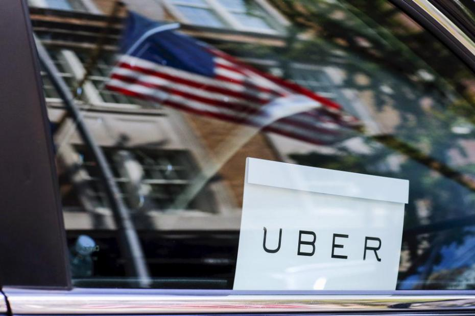 An Uber sign is seen in a car in New Yor