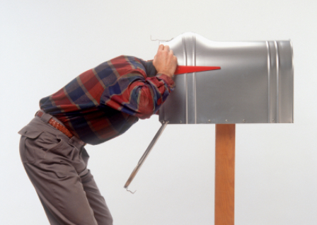 Man-with-head-in-mailbox