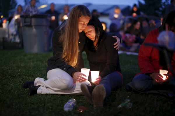 Heidi Wickersham (L), 31, comforts her sister Gwendoline Wickersham, 28, after t