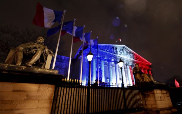 France's National Assembly  lit with the colors of the