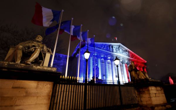 France's National Assembly  lit with the colors of the French flag in Paris, Nov. 19, 2015, to honor victims of the recent attacks. [Reuters]
