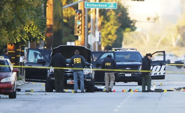 FBI and police are seen around a vehicle in which two shooters were killed following a mass shooting in San Bernardino.  REUTERS/Mike Blake