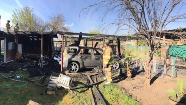 A mirrored headboard started a carport fire in Fresno, fire officials said. (Fresno FD)