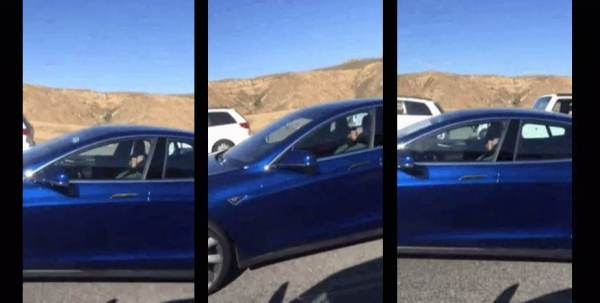 Tesla driver sleeping at the wheel while car drives itself