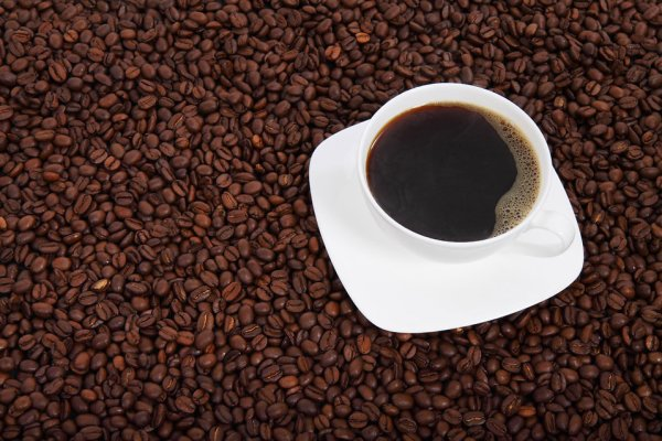 10638-a-cup-of-coffee-on-a-bean-background-pv