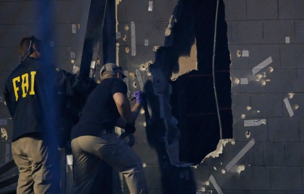 Police forensic investigators work at the crime scene of a mass shooting at the Pulse gay night club in Orlando, FL. June 12, 2016. REUTERS