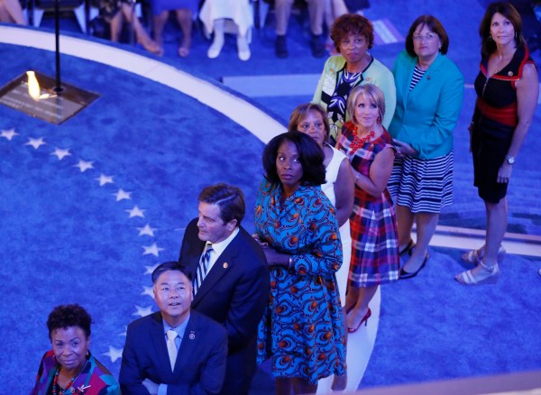 Congressional candidates that are running for office and being supported by the Democratic Congressional Campaign Committee watch a video while standing onstage at the Democratic National Convention in Philadelphia, Pennsylvania, U.S. July 27, 2016.   REUTERS
