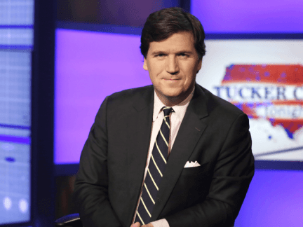 "Tucker Carlson, host of ""Tucker Carlson Tonight,"" poses for photos in a Fox News Channel studio, in New York, Thursday, March 2, 2107. (AP Photo/Richard Drew)"