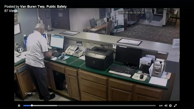 Police Video shows gunman fire at motel front desk during