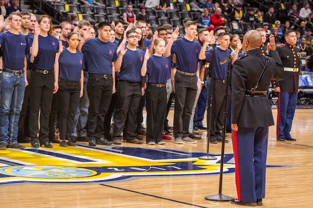 Local poolees take oath of enlistment in Denver Pepsi Center \u003e 8th