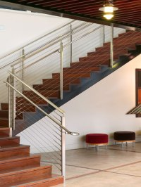 Custom commercial railing with cable rail infill | Feeney ...