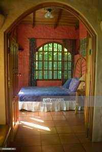 Bedroom Through Arched Doorway Stock Photo | Getty Images