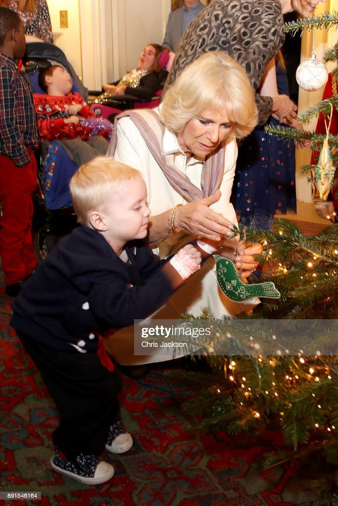 Camilla Duchess Of Cornwall Is Seen With A Child From