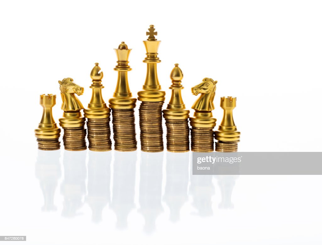 Gold Chess Pieces Chess Pieces On Stacked Golden Coins Stock Photo Getty Images