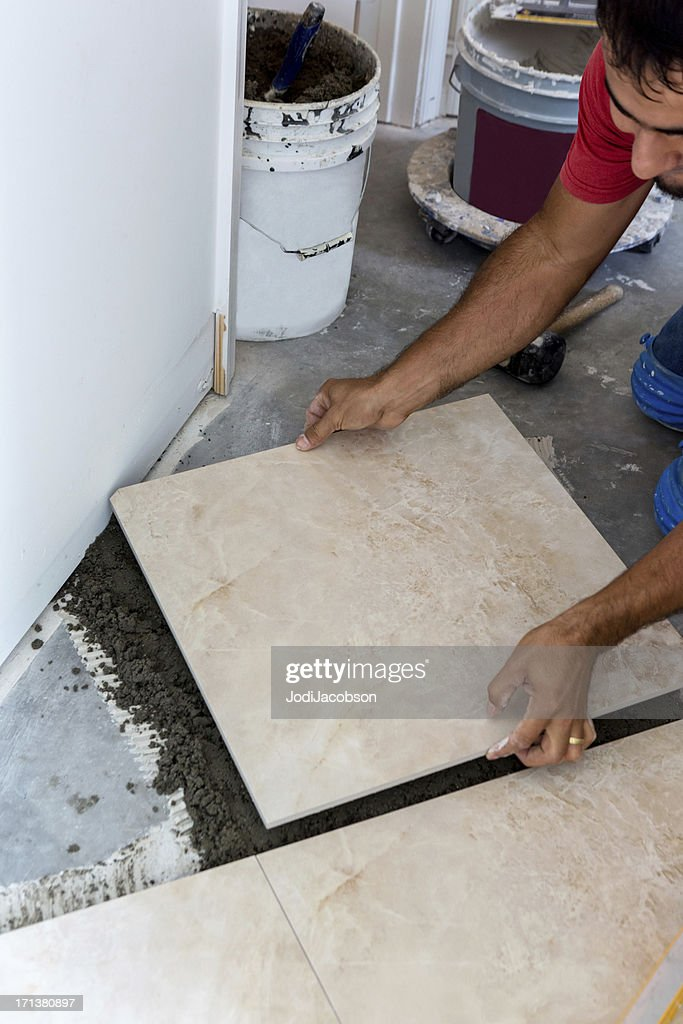 Construction Laying A Porcelain Tile Floor Stock Photo | Getty Images