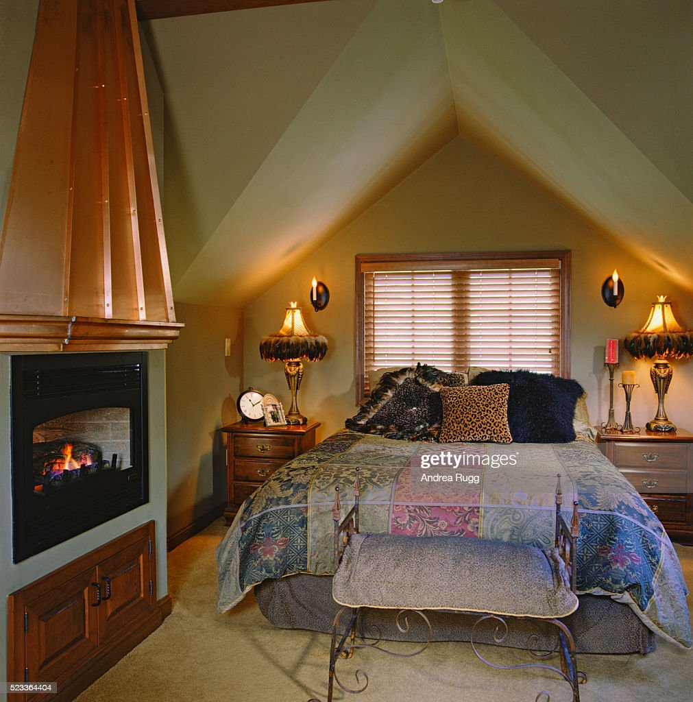 Copper Fireplace Mantel Copper Fireplace Mantel In Attic Bedroom Stock Photo Getty Images