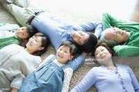 Family Lying Down On Carpet Stock Photo | Getty Images