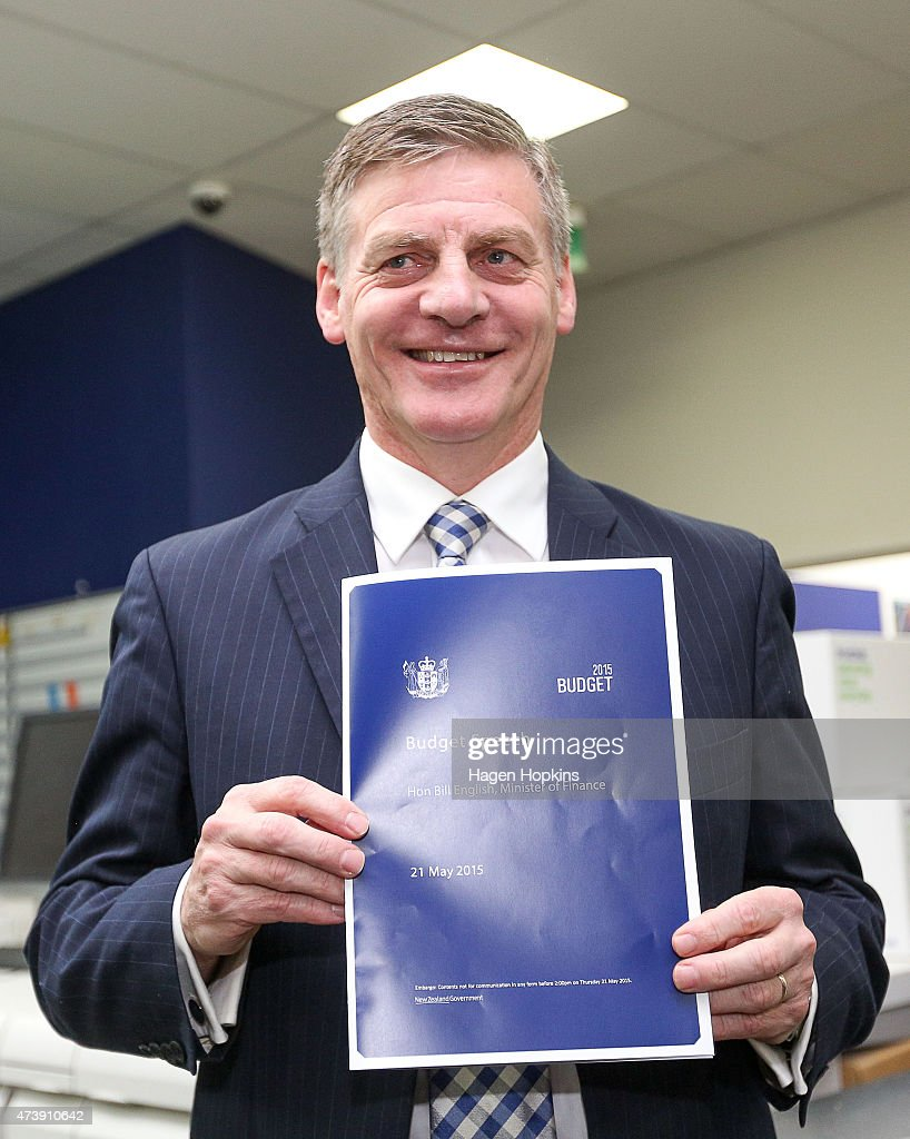 Finance Minister Bill English Poses With A Copy Of His