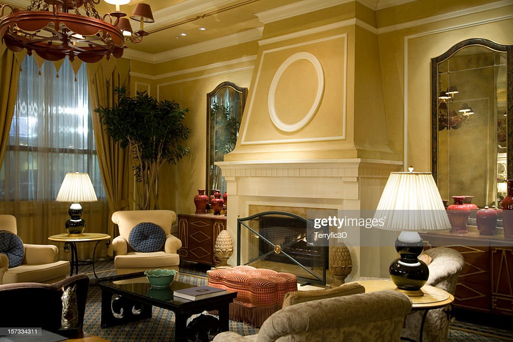 Fireplace With Comfy Chairs In Luxury Hotel Lobby