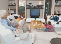 Grandma Watching Tv Stock Photos and Pictures | Getty Images