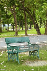 Green Old Chair In Park Stock Photo | Thinkstock