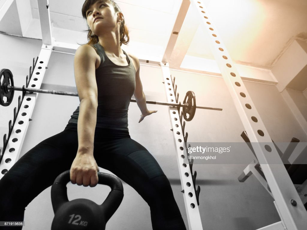 Kettlebell Bodybuilding Healthy Asian Woman Lifting Kettlebell For Weight Training And