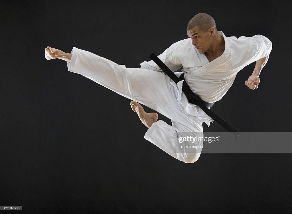 Hd Girl Wallpaper Print Hispanic Male Karate Black Belt Kicking In Air Stock Photo