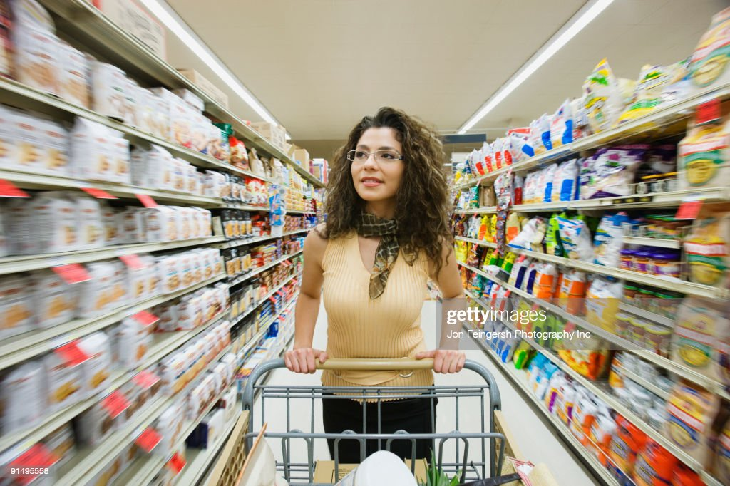 Hispanic Woman Shopping In Grocery Store High Res Stock