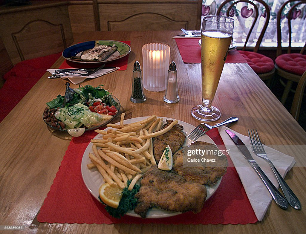 Schnitzel Restaurant Huhner Schnitzel And Gemischter Salat And An Beer Are Specialties