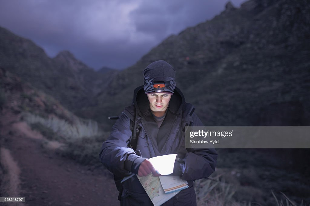 Lampe Exterieur Nature Et Decouverte Man Trekking At Night In Mountains Looking At Map Photo
