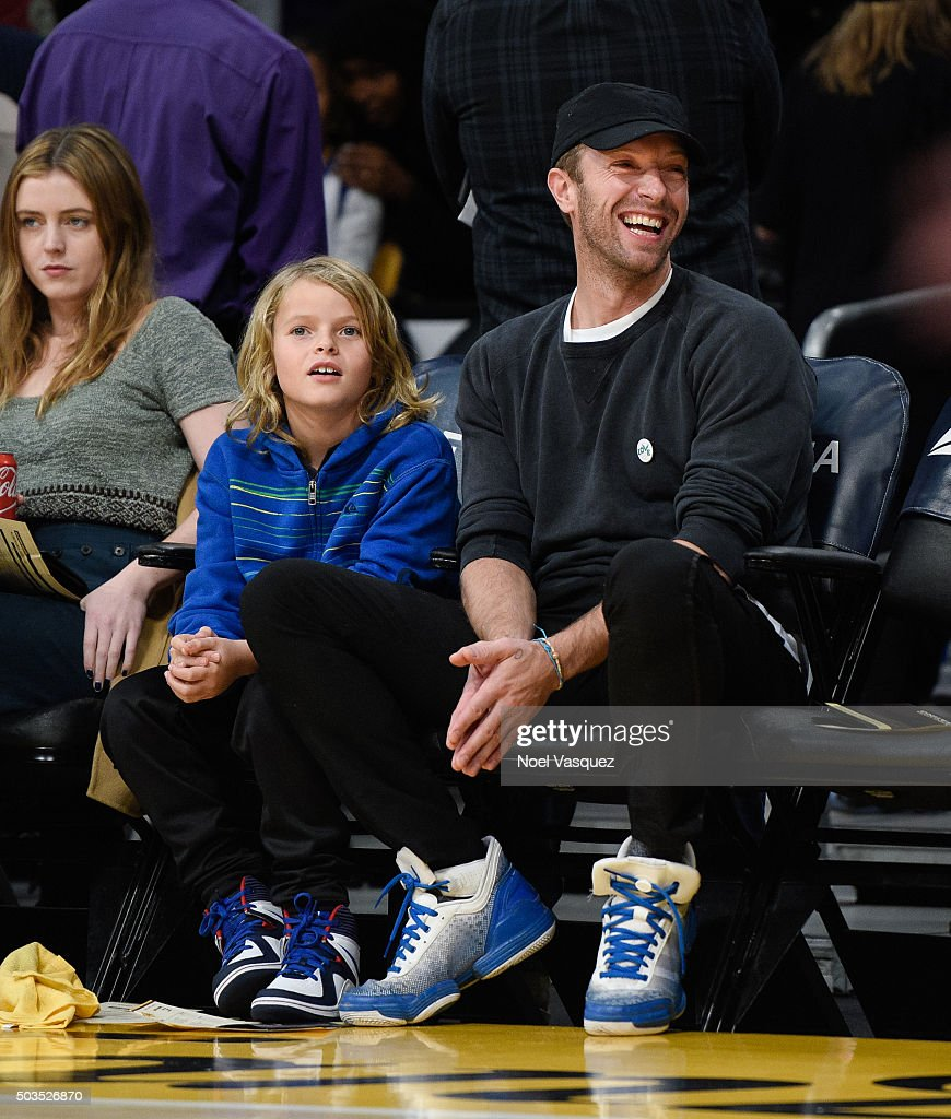 Moses martin l and chris martin attend a basketball game between the golden state