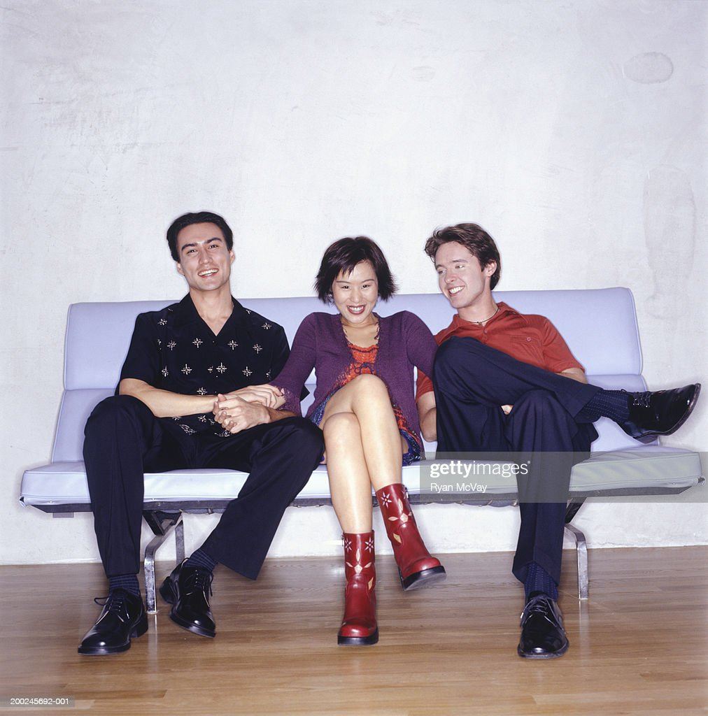 One Woman And Two Men Sitting On Retro Sofa High Res Stock Photo Getty Images