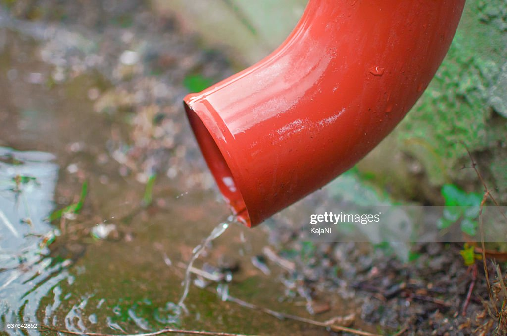 Rain Water Flowing From Drain Pipe Stock Photo
