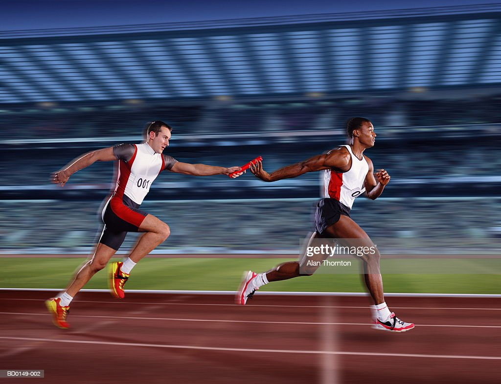 Relay race male athletes passing relay baton digital composite