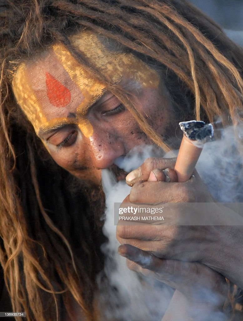 Shiva Chillum Hd Wallpaper A Sadhu Smokes Ganja In A Chillum As A Holy Offering From