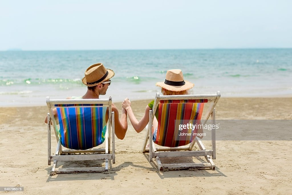 Man Sitting Beach Chair Rear Stock Photos And Pictures