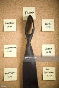 Tie Hanging On Bulletin Board With Reminder Notes Stock ...
