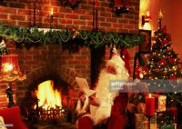 View Of Santa Sitting In A Decorated Living Room With A ...