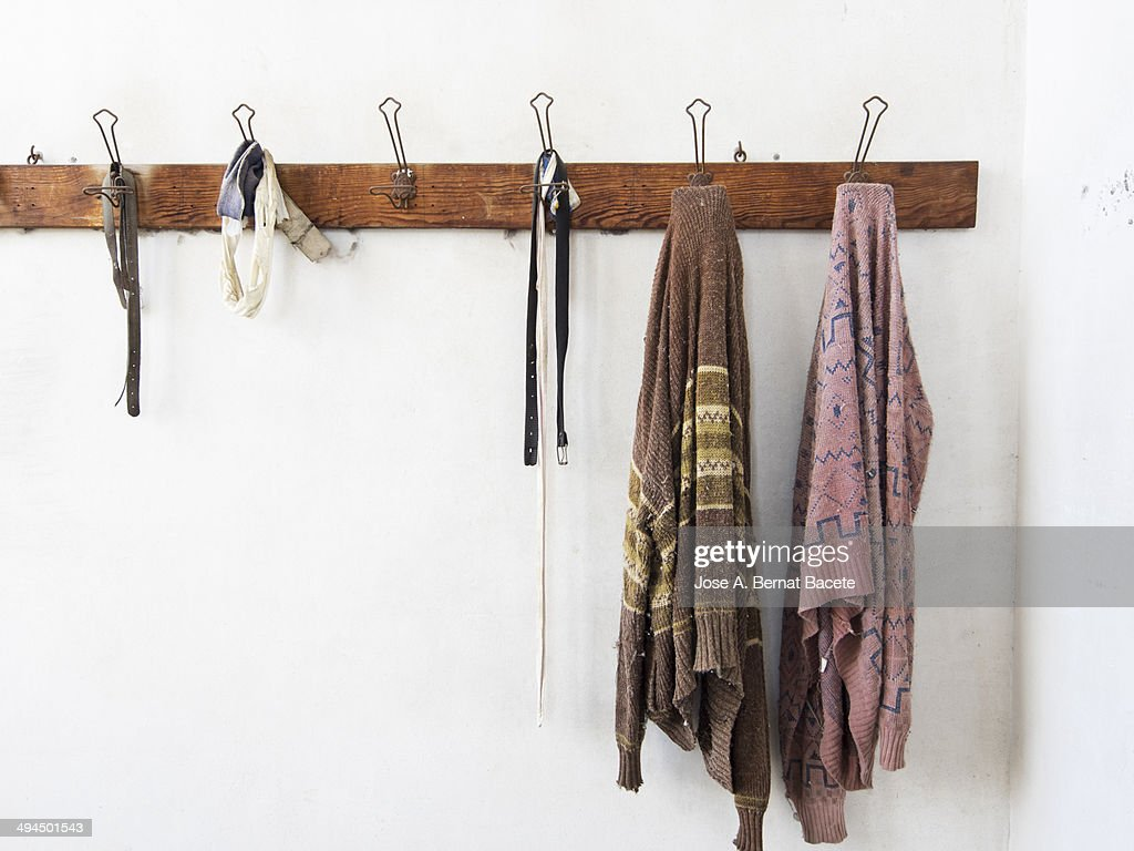 Clothes Hanger Wall Wooden Coat Rack Wall Hanging With Old Clothes Stock Photo