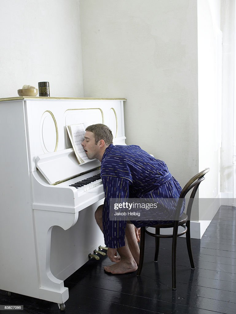 Dressing A Composer Young Man Wearing Dressing Gown Playing Piano Stock Photo Getty