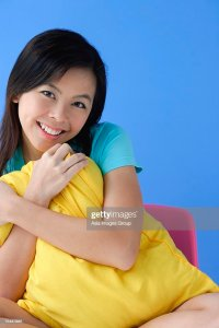 Young Woman Hugging Pillow Portrait Stock Photo | Getty Images
