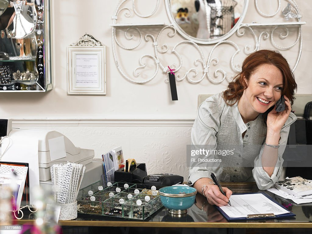 Gift For New Homeowner Woman Young Woman Owner Of Gift Shop Leaning On Checkout Counter