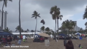Waterspout makes landfall and flips bouncy castle in air with children inside