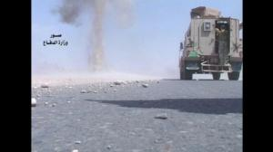 Iraqi military disarms roadside bombs in footage released to AP