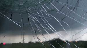 Footage captures large hail break car's windshield