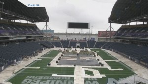 What goes into prepping a football field for the NHL Heritage Classic game